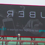 Digital billboard display of Uber ad created by Iowa State students
