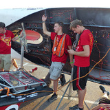Students recharging the Team PrISUm solar racing car