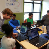 Students designing gliders on computers