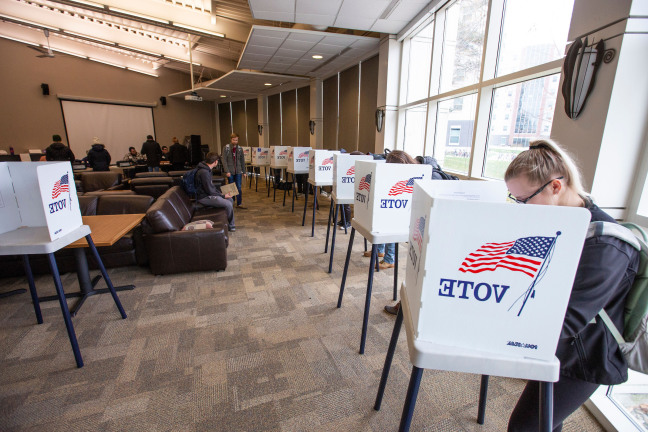 Students voting in Buchanan Hall on campus