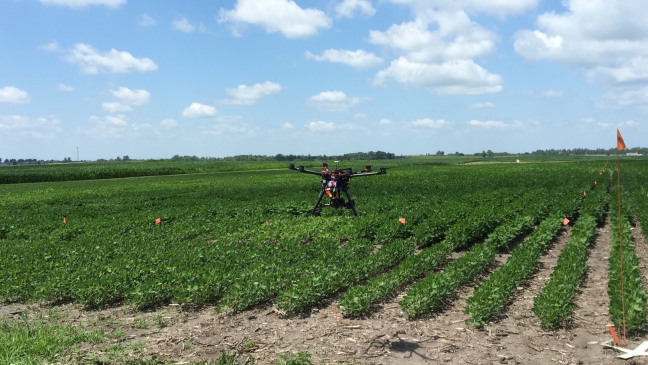 An unmanned aerial vehicle lands in a farm field