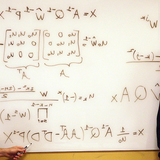 Alex Stoytchev and Vladimir Sukhoy with some of their equations and matrices.