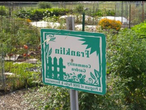 A sign from a community garden in Des Moines