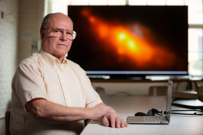 Allen Lawrence with the rare double-nucleus galaxy he helped reveal.